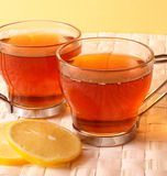 Tea. Time -  cups with lemon close-up royalty free stock photo