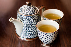 Tea. A pot of tea readily served in two cups Stock Photo