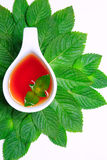 Tea. With green leaves on a white background an ideal drink and healthy food Royalty Free Stock Images