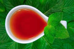 Tea. With green leaves on a white background an ideal drink and healthy food Stock Photography