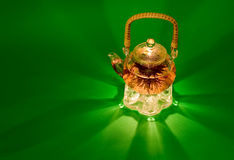 Tea. Hot green Chinese tea in a glass pot on a green background Stock Photography