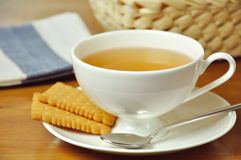 Tea. In a cup of tea and biscuits Royalty Free Stock Images