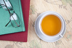 Tea. Cup of green tea on bright background Royalty Free Stock Photography