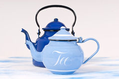 Tea. Blue kettle for tea on white background Royalty Free Stock Images