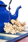 Tea. Blue old kettle for tea on white background Stock Photo