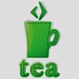 Tea. Mug with tea and label with the bottom of the tea Stock Photography