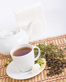 Tea. With herbs and lemon and pot Royalty Free Stock Image