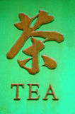 Tea. A sign in a shop window for tea, in Chinese calligraphy/characters and english text Royalty Free Stock Images