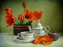 Tea. Afternoon drum-up with red tulips Stock Image