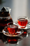 Tea. Fruit tea in teapot and teacups Royalty Free Stock Photos