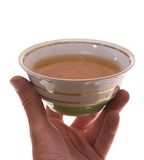 Tea. Photo cup of tea in his hand on a white background Stock Images