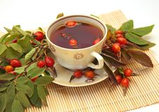 Tea. Cup of tea and berry of a dogrose royalty free stock images