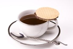 Tea. White tea cup on white background with cookie and spoon Stock Images