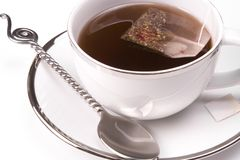Tea. White tea cup on white background with tea bag Royalty Free Stock Images