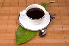 Tea. Cup on brown  with a green leaf Royalty Free Stock Images