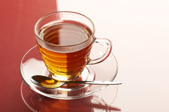 Tea. Cup of tea over red Royalty Free Stock Image