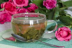 Tea. A cup of tea with rosa Stock Images