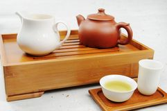 Tea. Pot and cups filled with Royalty Free Stock Images