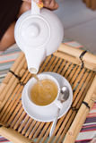 Tea. Closeup picture of tea ceremony set in action Royalty Free Stock Photos