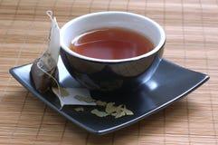 Tea. Closeup shot of teacup and tea bag Royalty Free Stock Photo