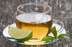 Glass Cup of Green Tea with Lime Stock Photography