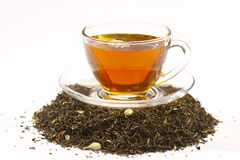 Tea. Cup of green tea and tea leaves with dry jasmin Stock Photography