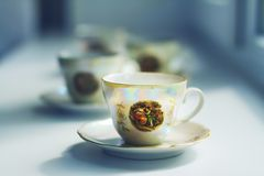 Tea in an antique porcelain cup Royalty Free Stock Photos