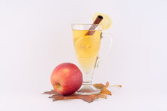 Tea and Apple. Beautiful autumn composition with red apple and tea with cinnamon and lemon on a white background stock images