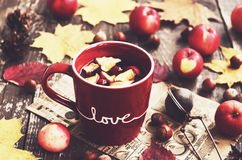 Tea with apple and cranberry and autumn leaves Stock Image