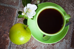 Tea with an apple Stock Image