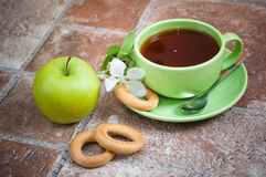 Tea with an apple Stock Photos