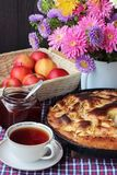 Tea and Apple pie Charlotte. Food still life. Cake, drink, flowers and apples on the table stock photography