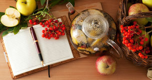 Tea, apples and diary Stock Photography