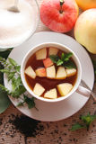 Tea with apples and mint. Black tea with cut apples and mint Stock Photo
