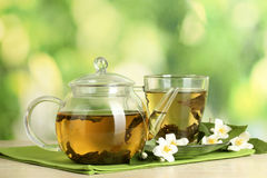 Tea. Is an aromatic beverage commonly prepared by pouring hot or boiling water over cured leaves of the Camellia sinensis, an evergreen shrub native to Asia Royalty Free Stock Image