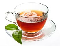 Tea. Is an aromatic beverage commonly prepared by pouring hot or boiling water over cured leaves of the Camellia sinensis, an evergreen shrub native to Asia Royalty Free Stock Photo