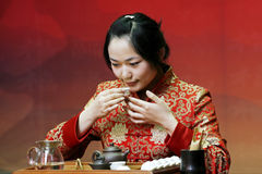 Tea art of China. A Chinese girl in traditional dress is performing tea art Royalty Free Stock Photography