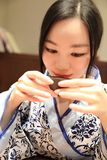 Tea art of China,drink tea. A Chinese girl in blue hanfu dress is performing tea art. China has history of tea culture for more than one thousand years.Chinese Stock Photos