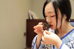 Tea art of China,drink tea. A Chinese girl in traditional dress blue hanfu is performing tea art. China has history of tea culture for more than one thousand Stock Photos
