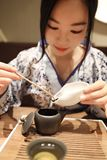 Tea art of China,make tea. A Chinese girl in blue hanfu dress is performing tea art. China has history of tea culture for more than one thousand years.Chinese Stock Image