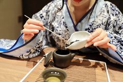Tea art of China,make tea. A Chinese girl in blue hanfu dress is performing tea art. China has history of tea culture for more than one thousand years.Chinese Royalty Free Stock Images