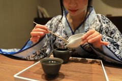 Tea art of China,make tea. A Chinese girl in traditional dress blue hanfu is performing tea art. China has history of tea culture for more than one thousand Stock Images