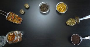 Tea assortment natural with tea flowers at black wooden background royalty free stock photo