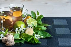 Tea background . Tea in transparent mugs with lemon, lemons, lim Stock Photography