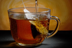 Tea bag. Glass cup on the table. Tea bag. Boiling water Stock Photo