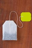 Tea bag. On wooded background Royalty Free Stock Image