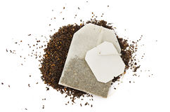 Tea bag. With a blank label and tea herbs on a white background royalty free stock photo