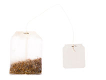Tea bag with blank label on a string Royalty Free Stock Photography