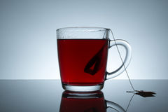 Tea bag is brewed in water Royalty Free Stock Images