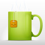 Tea bag brewing in mug Stock Images